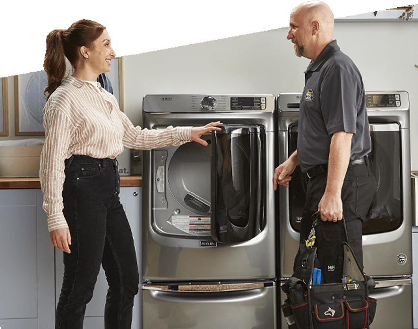 Technician with customer looking at dryer